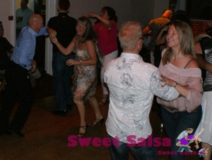 All smiles at the salsa dancing party