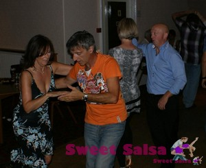 Two couples dancing salsa