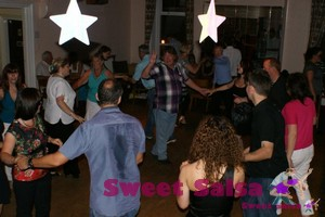 Teacher leads a rueda or Cuban Wheel at the salsa party