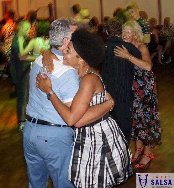 Couple embrace after a dance