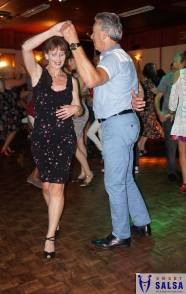 Couple concentrating on the salsa moves