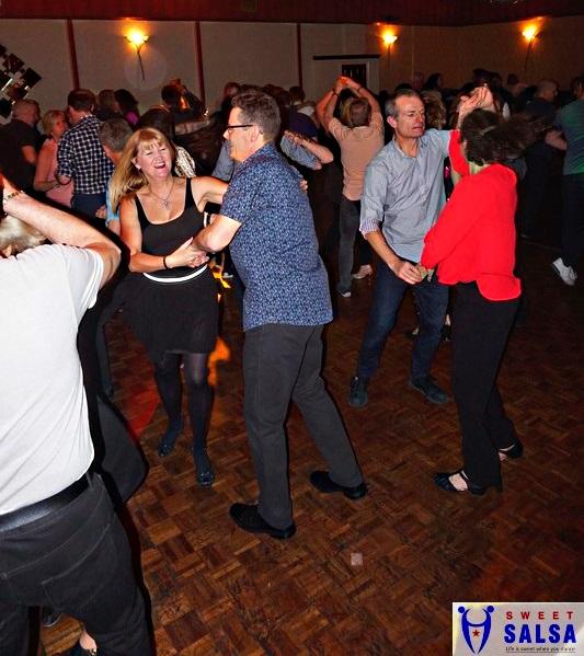 people dancing to salsa music