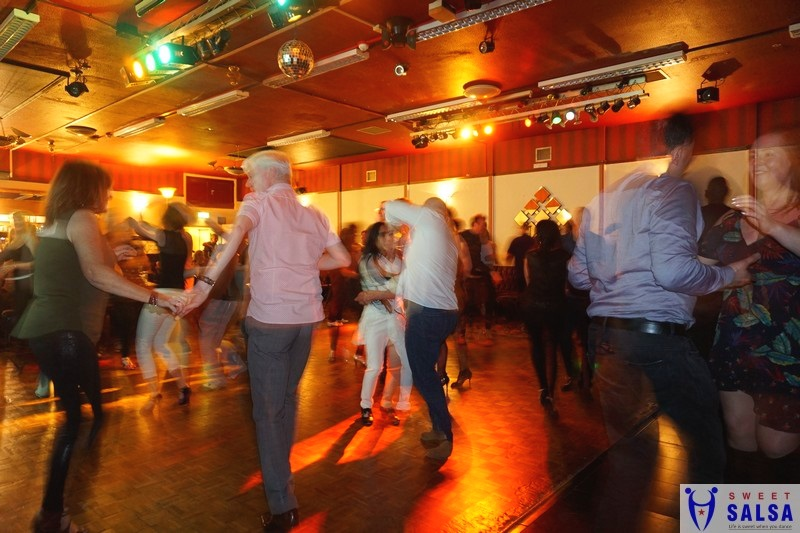 Lots of people dancing to the music
