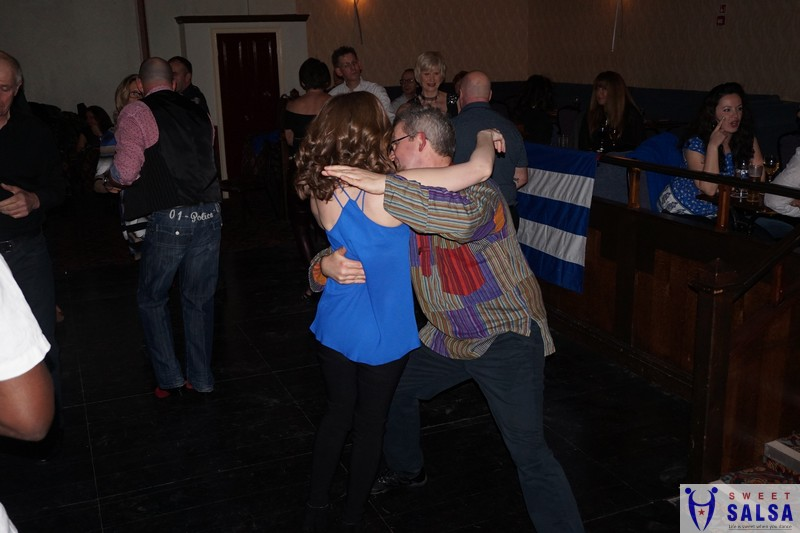 Dancing to salsa music January 2018