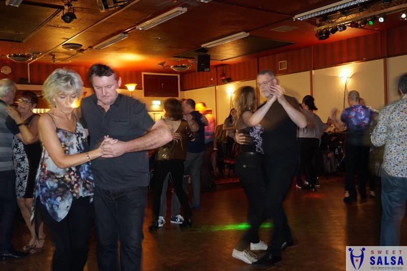 Many people dancing to kizomba