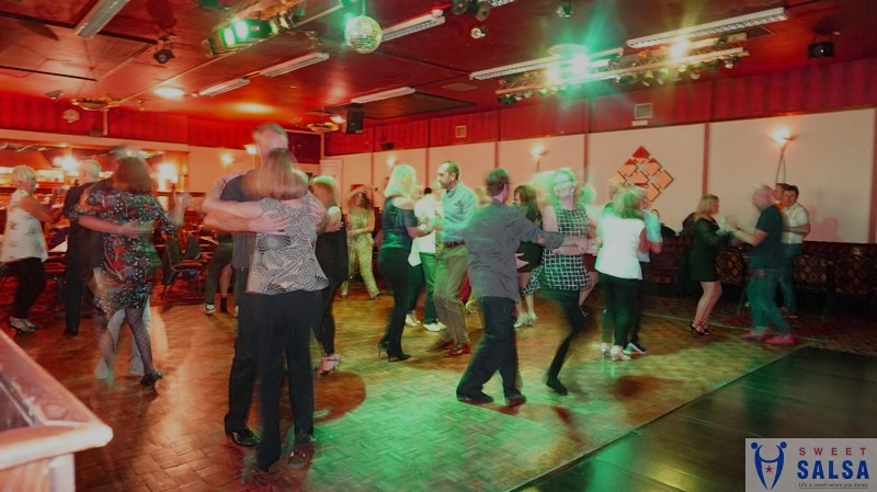 Busy salsa dancing party night