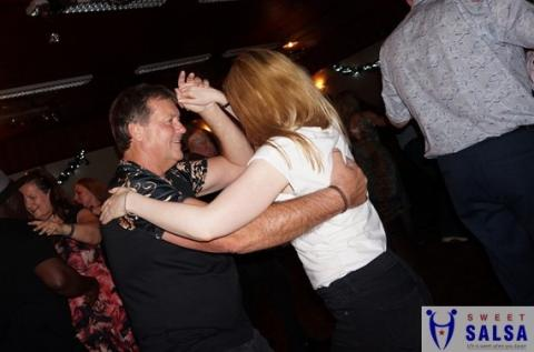 two people dancing to salsa music