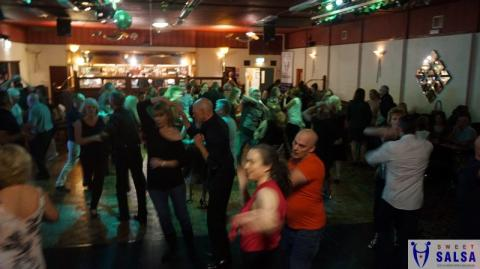 Many people dancing on a busy dance floor
