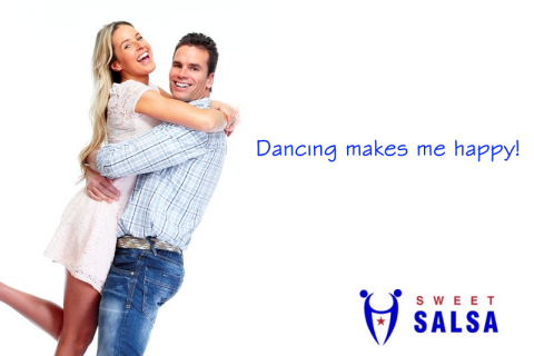 couple smiling and dancing together