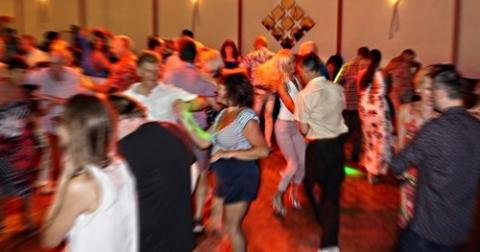 People dancing salsa at The Canberra Club
