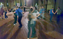 many people dancing salsa at St Walburges Community Hall